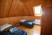 Podwójna sypialnia w domu letniskowym dla 9 - 16 osób w Pobierowie